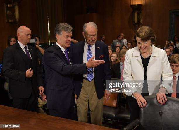 Christopher Wraygestures to Sen Dianne Feinstein and Sen Chuck Grassley Chairman Judiciary Committee as he arrives to testify before the Senate...