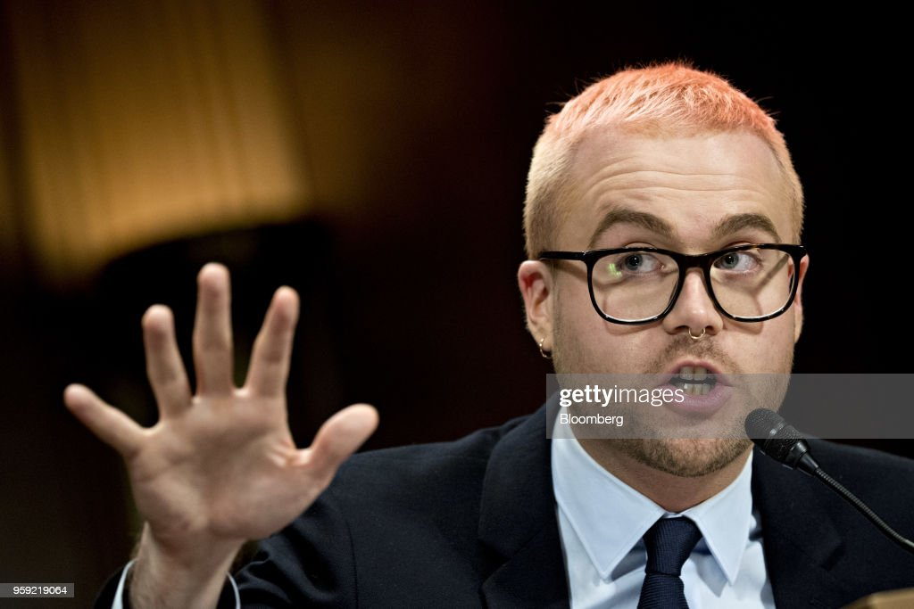 Christopher Wylie, a whistleblower and former employee with Cambridge Analytica, speaks during a Senate Judiciary Committee hearing in Washington, D.C., U.S., on Wednesday, May 16, 2018. Cambridge Analytica is a U.K.-based data broker that improperly gained access to tens of millions of Facebook users' personal data. The firm, which announced its dissolution earlier this month, used the Facebook data in targeted influence campaigns for Donald Trump's 2016 presidential campaign. Photographer: Andrew Harrer/Bloomberg via Getty Images