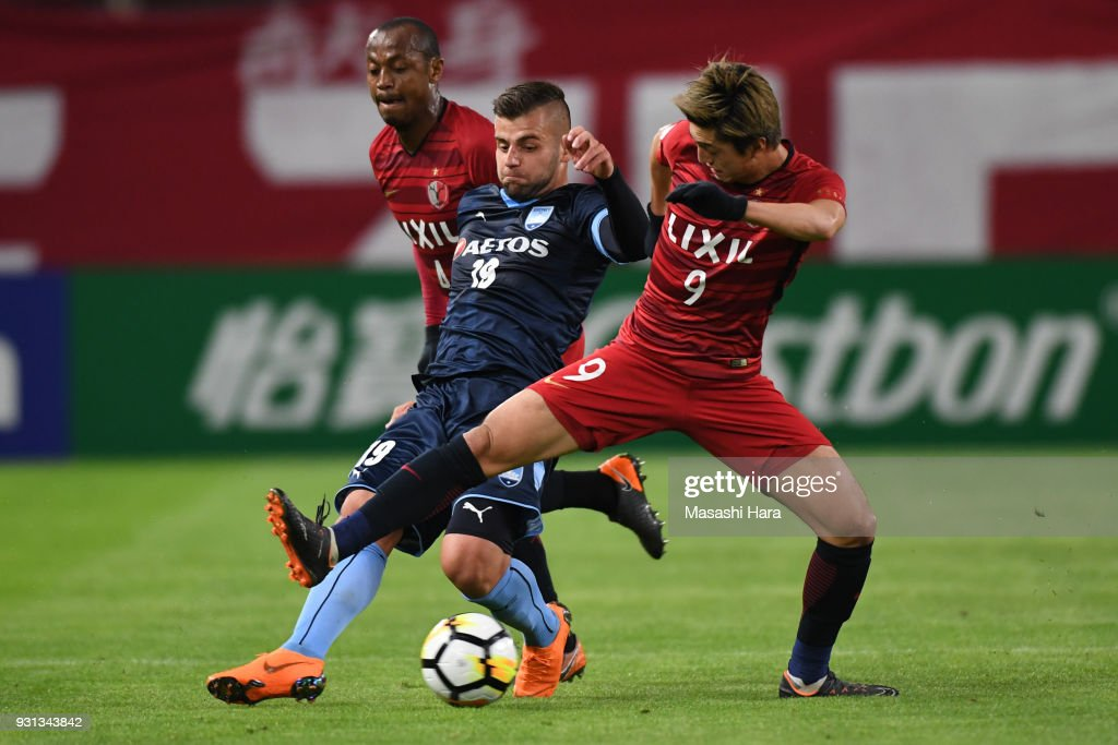Christopher Zuvela of Sydney FC and Yuma Suzuki of Kashima Antlers compete for the ball during the AFC Champions League Group H match between Kashima Antlers and Sydney FC at Kashima Soccer Stadium on March 13, 2018 in Kashima, Ibaraki, Japan.