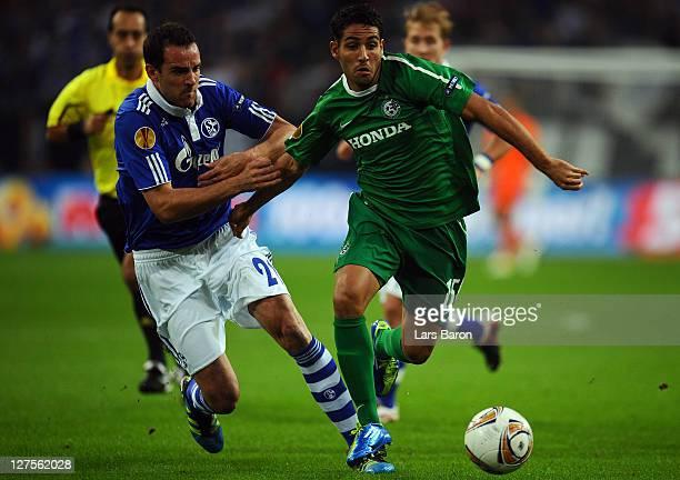 ChristophMetzelder of Schalke challenges Eyal Golasa of Haifa during the UEFA Europa League group J match between FC Schalke 04 and Maccabi Haifa FC...