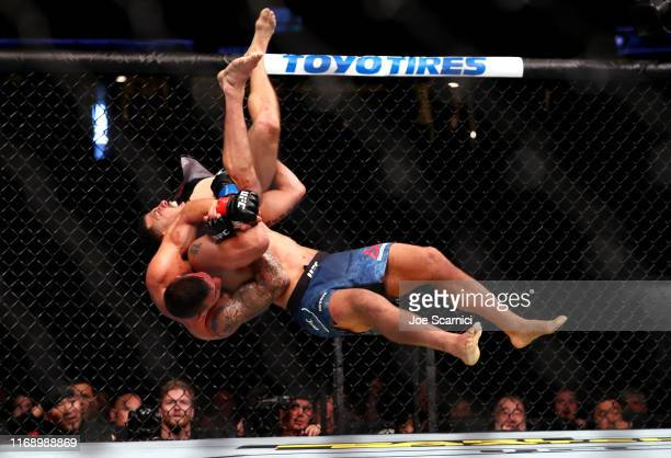 Christos Glagos is slammed onto the ground by Drakkar Klose in the third round during their Lightweight Bout at UFC 241 at Honda Center on August 17,...