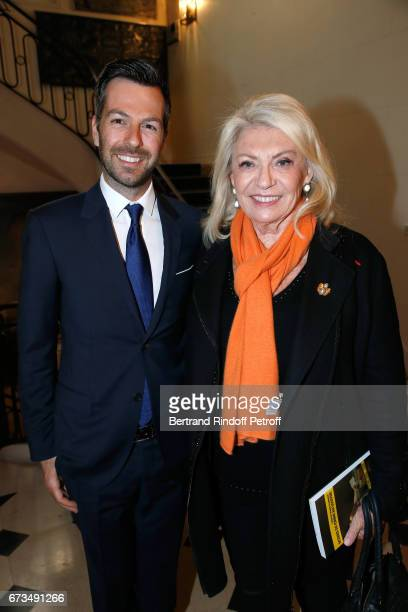 Christos Markogiannakis and Elizabeth Dauchy attend the presentation of the Book 'Scenes De Crime au Louvre' written by Christos Markogiannakis at...
