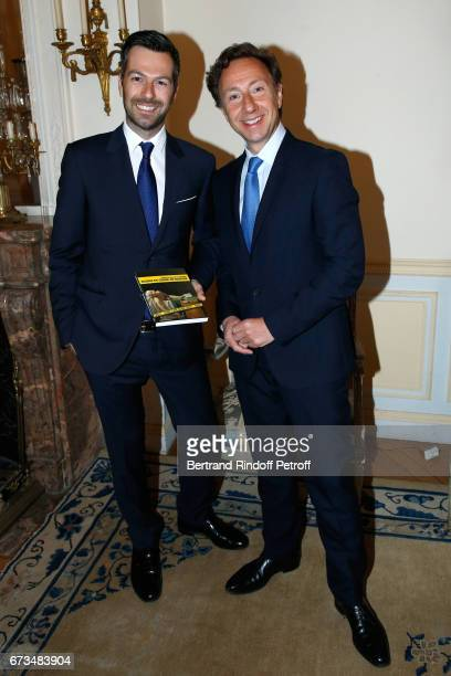 Christos Markogiannakis and Stephane Bern attend the presentation of the Book 'Scenes De Crime au Louvre' written by Christos Markogiannakis at...