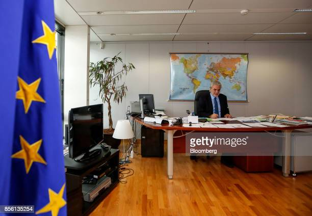 Christos Stylianides humanitarian aid commissionerfor the European Union sits at his desk following an interview at the EU Commission in Brussels...