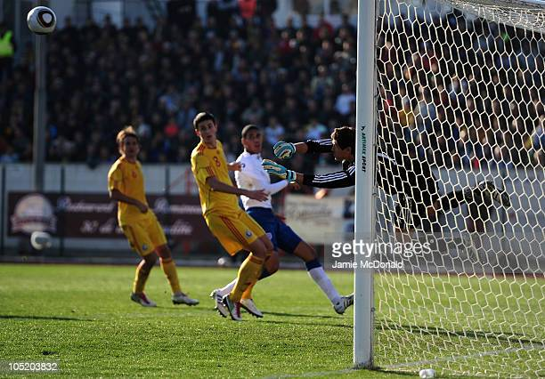 Christpher Smalling of England U21 is foiled by Silviu Lung of Romania U21 during the UEFA Euro 2011 U21 Championship play-off, second leg match...