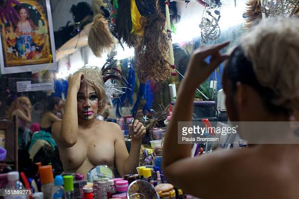 Christy a ladyboy dancer at the Chiang Mai Cabaret show does her makeup for her half malefemale routine before a performance September 8 2012 in...