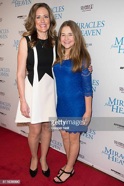 Christy Beam and Annabel Beam pose for a photo on the red carpet for the premiere of 'Miracles From Heaven' on February 21 2016 in Dallas Texas