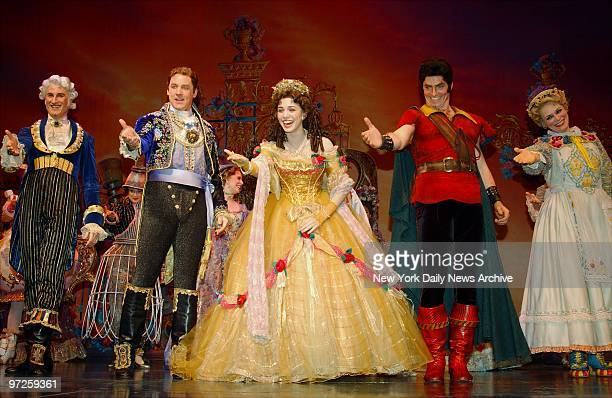 Christy Carlson Romano and the cast of Beauty and the Beast take a curtain call at the Lunt Fontanne Theatre following a performance marking the...