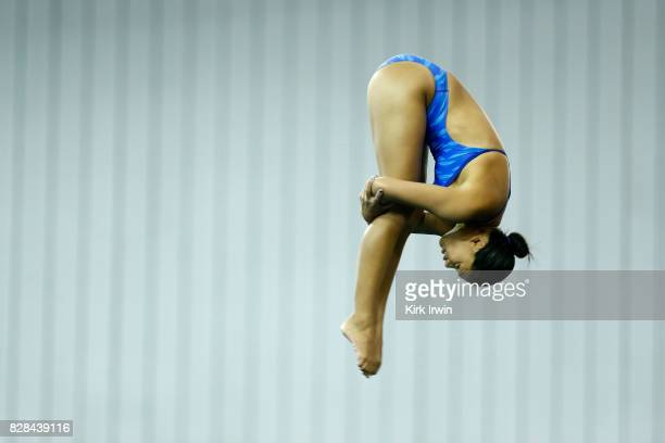 Christy Cutshaw of North Carolina Diving holds a pike position while diving during the Senior Women's Platform Semifinal during the 2017 USA Diving...