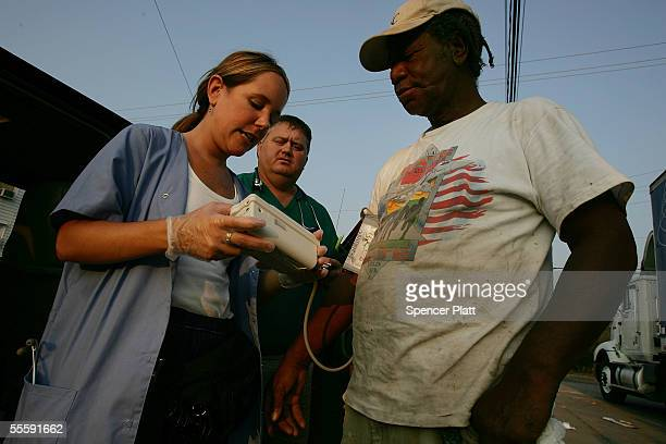 Christy Fountain a nurse with our Lady of Fatima Church takes the blood pressure of Wille Smith September 15 2005 in Biloxi Mississippi Thousands of...