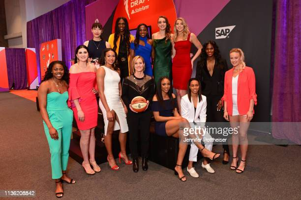 Christy Hedgpeth poses for a photo with the 2019 draft class before the WNBA Draft on April 10 2019 in New York New York at the Nike New York...