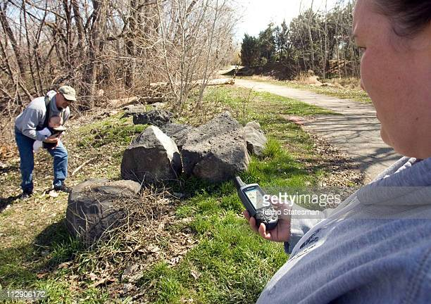Christy Lytle holds a GPS device that put she and her husband Rob Lytle and their 5monthold daughter Makayla within about 10 feet of a geocache...