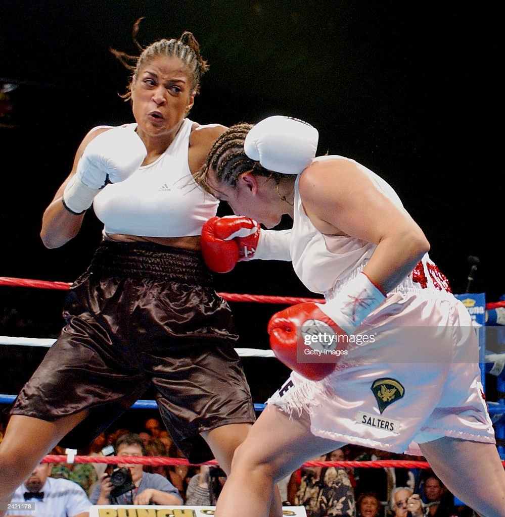 Christy Martin lands a punch on Laila Ali on August 23, 2003 at the Mississippi Coast Coliseum in Biloxi, Mississippi. Ali would knock out Martin in the fourth round.