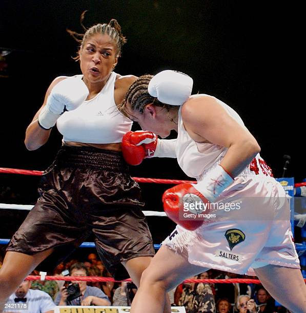 Christy Martin lands a punch on Laila Ali on August 23 2003 at the Mississippi Coast Coliseum in Biloxi Mississippi Ali would knock out Martin in the...