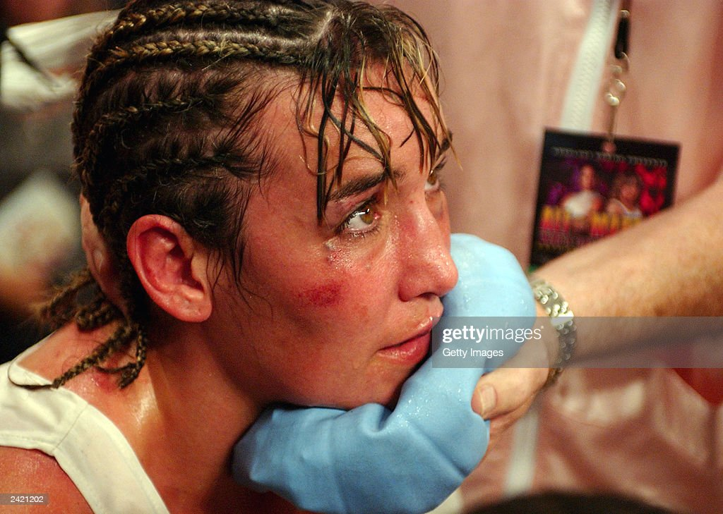Christy Martin rests in her corner after being defeated by Laila Ali in the fourth round on August 23, 2003 at the Mississippi Coast Coliseum in Biloxi, Mississippi.