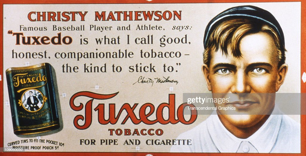 Christy Mathewson, pitcher for the New York Giants, appears on a trolley car sign advertising Tuxedo tobacco, issued circa 1910 in New York City.