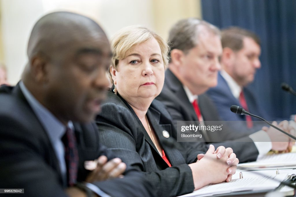 Christy McCormick, vice chair of the U.S. Election Assistance Commission (EAC), second left, listens during a Senate Rules and Administration Committee hearing on election security in Washington, D.C., U.S., on Wednesday, July 11, 2018. The EAC, one of the smallest federal agencies with the big job of helping to protect voting systems from foreign interference is in charge of distributing $380 million in new grants to states for election security, with the goal of getting the money out in time to upgrade voting systems by November. Photographer: Andrew Harrer/Bloomberg via Getty Images