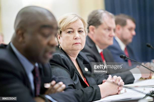 Christy McCormick vice chair of the US Election Assistance Commission second left listens during a Senate Rules and Administration Committee hearing...