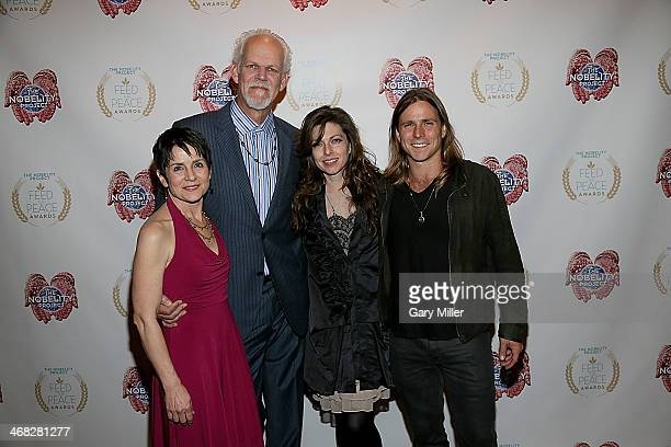 Christy Pipkin Turk Pipkin Amy Nelson and Lukas Nelson walk the red carpet during the Feed The Peace Awards banquet at the Four Seasons Hotel on...