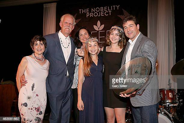 Christy Pipkin, Turk Pipkin, Kathryn Chandler, Sawyer Chandler, Sydney Chandler and Kyle Chandler pose with the Feed The Peace Award during the 10th...