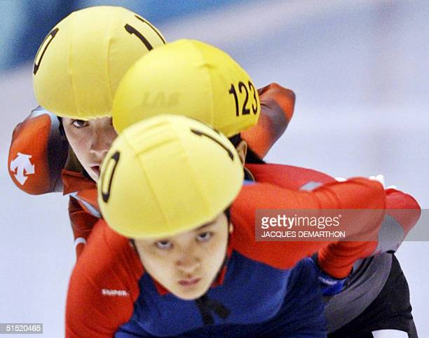 Christy Ren of Hong Kong skates ahead of Chinese Yang Yang and Canadian MarieEve Drolet during the women's 1000m heats of the short track speed...