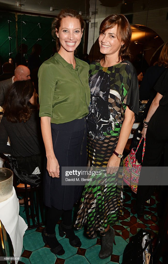 Christy Turlington Burns (L) and Yasmin Le Bon attend a dinner hosted by PORTER in honour of cover girl Christy Turlington Burns and her charity Every Mother Counts at Mr Chow on November 18, 2014 in London, England.