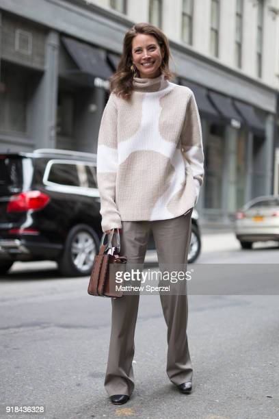 Christy Turlington is seen on the street attending EDUN during New York Fashion Week wearing a beige/white sweater with grey slacks and brown bag on...