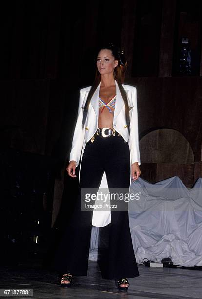 Christy Turlington walk the runway at the Rock N' Rule Benefit Gala for AmFar hosted by Versace circa 1992 in New York City