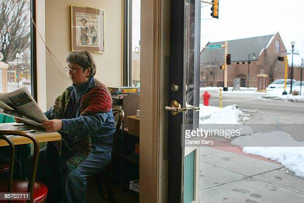 Christyann Ranck reads a newspaper in a cafe March 30 2009 in downtown Fargo North Dakota Residents of Fargo and the surrounding area are awaiting...