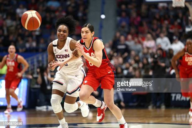 Christyn Williams of the UConn Huskies and Kelsey Plum of the USA Women's National Team look to grab the loose ball on January 27 2020 at XL Center...
