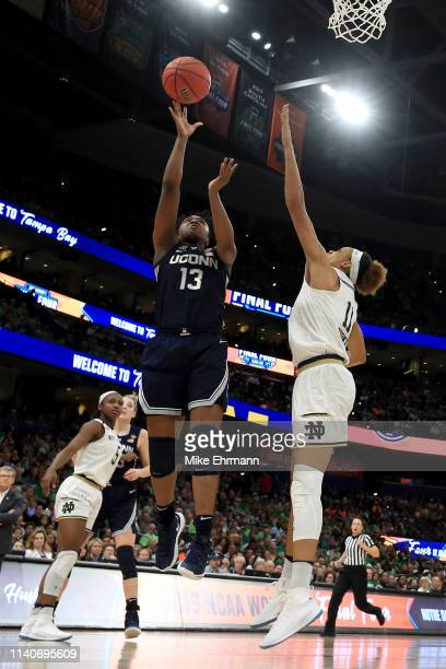 Christyn Williams of the UConn Huskies attempts a shot against Brianna Turner of the Notre Dame Fighting Irish during the fourth quarter in the...
