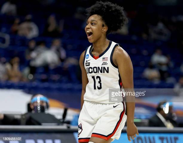 Christyn Williams of the UConn Huskies celebrates her three point shot in the first half against the Iowa Hawkeyes during the Sweet Sixteen round of...