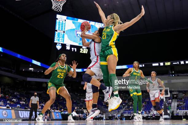 Christyn Williams of the UConn Huskies drives to the basket against DiJonai Carrington of the Baylor Lady Bears during the first half in the Elite...