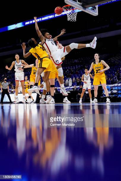 Christyn Williams of the UConn Huskies drives to the net ahead of Tomi Taiwo of the Iowa Hawkeyes during the second half in the Sweet Sixteen round...