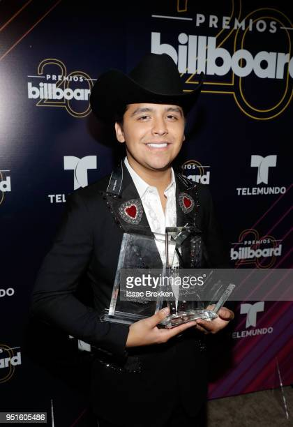 Chritstian Nodal poses with the awards for New Artist of the Year Regional Mexican Song of the Year and Regional Mexican Artist of the Year Solo in...