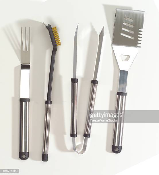 chrome bbq tool set - cooking utensil stock photos and pictures