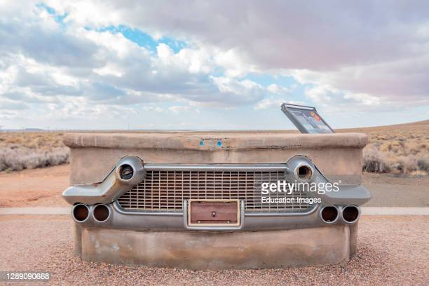Chrome car bumper and grill encased in concrete at Route 66 Monument in the Petrified Forest National Park.