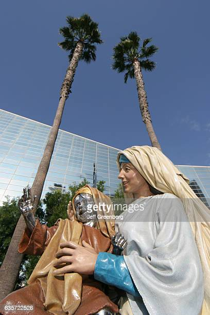 A chrome child Jesus statue held by Mary outside the Crystal Cathedral