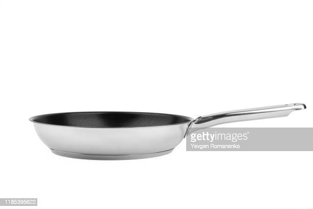 chrome frying pan with a non-stick teflon coating, isolated over the white background - saucepan stock pictures, royalty-free photos & images