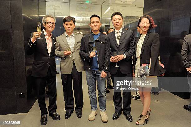 Chrome Hearts Beijing general manager Louis Tan and Hong Kong international actor Tony Leung posing with guests during the Chrome Hearts Beijing...