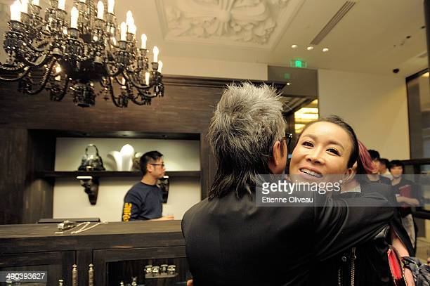 Chrome Hearts Beijing general manager Louis Tan welcomes Chinese Singer Na Ying during the Chrome Hearts Beijing Store Opening on May 14, 2014 in...