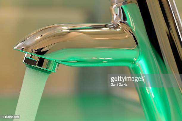 Chrome sink tap with running water