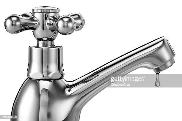 Chrome tap / faucet with water dripping from it