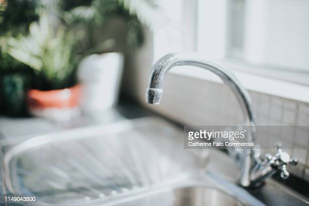 chrome tap in a kitchen - shiny stock pictures, royalty-free photos & images