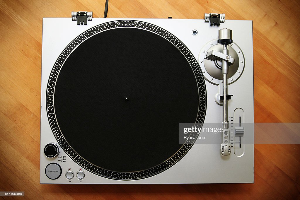 Chrome Turntable / Record Player on Wood Background : Stock Photo