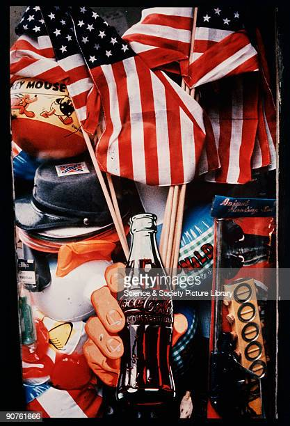 Chromogenic print by Tony RayJones of a bottle of CocaCola surrounded by typically American objects such as a Confederate soldier�s cap the Stars and...