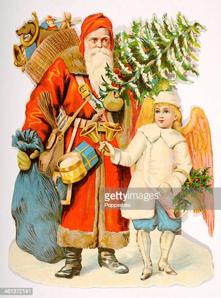 A chromolithograph featuring Santa Claus accompanied by an angel with baskets of toys and a Christmas tree circa 1900
