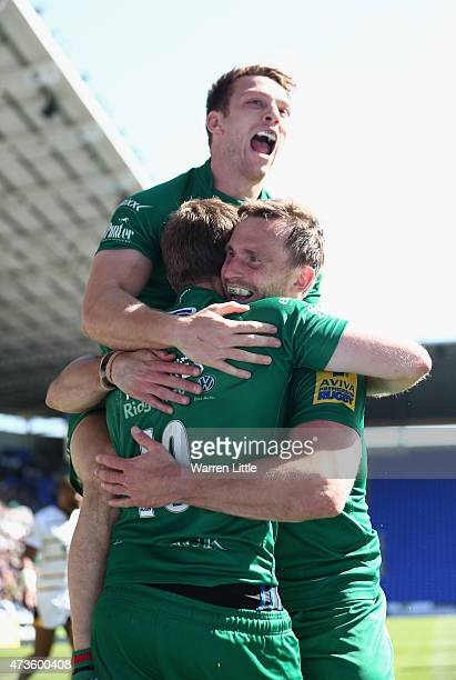 Chros Noaks of London Irish is congratulated after scoring a try during the Aviva Premiership match between London Irish and London Wasps at Madejski...