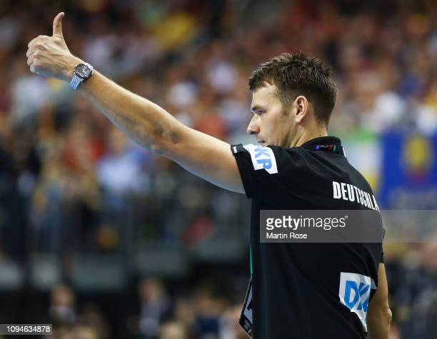 Chrsitian Prokop head coach of Germany gives the thumbs up during the 26th IHF Men's World Championship group A match between Germany and France at...