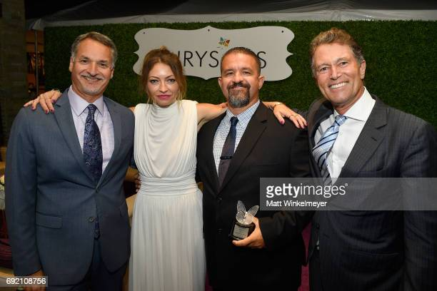 Chrysalis CEO Mark Loranger Chrysalis Butterfly Ball Cochair Rebecca GayheartDane Honoree Raymond Davis and Butterfly Ball Host Hayward Kaiser at the...